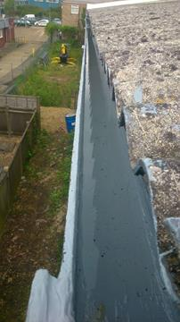 asbestos gutter lined with Liquasil's liquid gutter lining system