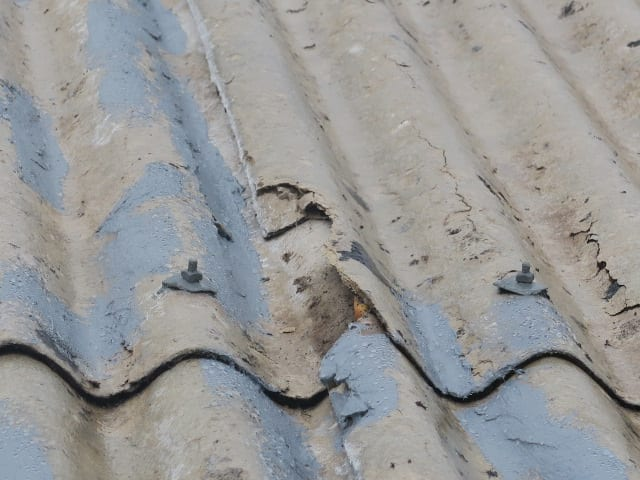 delaminating asbestos roof sheet